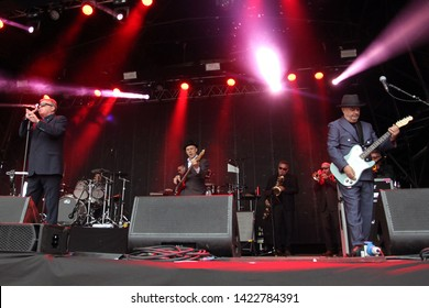 MARKET RASEN RACECOURSE, LINCOLNSHIRE, UK : 7 JUNE 2019 : Ever popular Ska Band Madness perform live on stage after horse racing at Market Rasen Racecourse