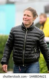 MARKET RASEN RACECOURSE, LINCOLNSHIRE, UK : 7 JUNE 2019 : Racehorse Trainer Lucinda Egerton looking wet at Market Rasen Races