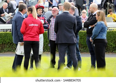 MARKET RASEN RACECOURSE, LINCOLNSHIRE, UK : 21 JUNE 2019 : Jockey Harry Skelton stands in the Parade Ring and chats to the horses Owners and Connections before racing at Market Rasen Races