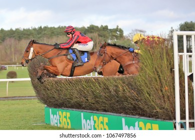 Market Rasen Racecourse, Lincs, UK, 17 January 2018 : Three Muskateers ridden by Harry Skelton and trained by Dan Skelton jumps the last fence in the Weatherbys Bank Graduation Chase