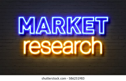 Market research neon sign on brick wall background