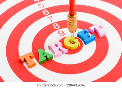 Market segmentation process 4P, customer focus group concept : Red dart hits in the center of a target, depicts aiming at consumers to deliver / offer product or service to serve buyers need or demand