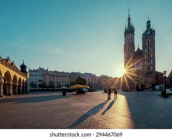 Market square in Krakow at sunrise. Mariacki Cathedral. Poland
