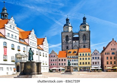 Market square in Wittenberg, main square of old german town. Monuments of Martin Luther and Philipp Melanchthon. Wittenberg is Luther City in Germany, UNESCO World Heritage Site