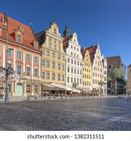 Market Square, Wroclaw, Poland - April 21, 2019: Central square and the City Hall in Wroclaw Old Town, surrounded by ornamented and colorful frontages of historical tenement houses