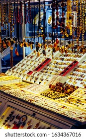 Market stall with baltic amber and silver jewellery souvenirs such as rings, pendant and necklaces