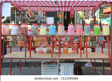 Market Stall With Candy Sweets in Big Jars