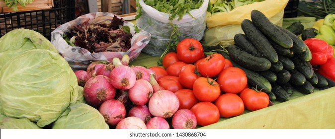 a market stall with different vegetables