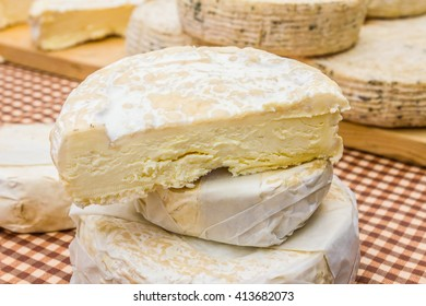 Market stall with fresh artisanal cheese