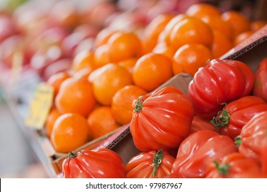 market stall with fresh beef tomatoes and mandarins