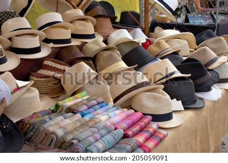 45738536 A market stall in Pollenca Mallorca Spain selling straw hats and colorful  striped scarves