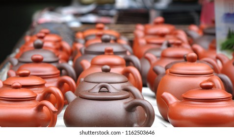 A market stall sells Chinese ceramic teapots