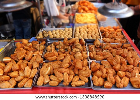 A market stall sells deep fried Chinese bread buns