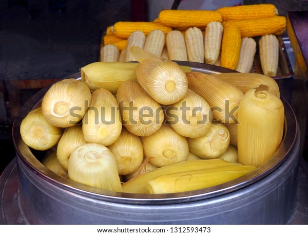A market stall sells freshly steamed corn