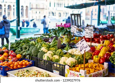 Market stall with vegetables and fruits in Venice Italy with sun Rialto