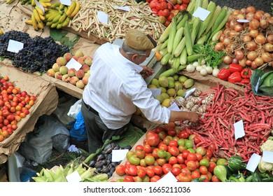 Market vendor on vegetable stall