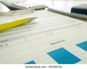 Marketer's desk with analysis Report,pen ,Calculator.selective focus.