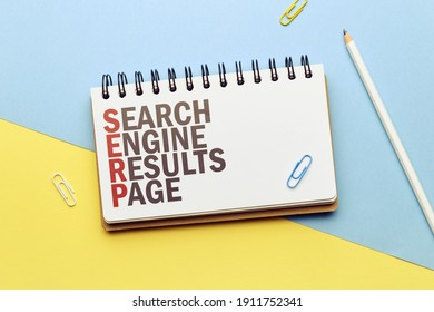 Marketing buzzword serp. Term Search engine results page on notepad.