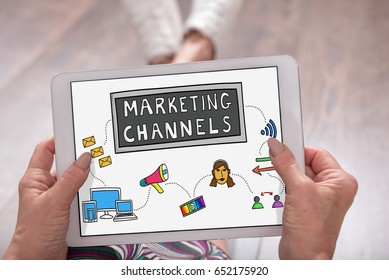 Marketing channels concept shown on a tablet held by a woman