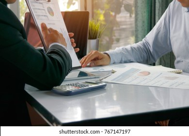 Marketing Concept Analysis : Businessmen together analyze the economic growth plan, pointing out the road map in the analytical papers as a marketing strategy.