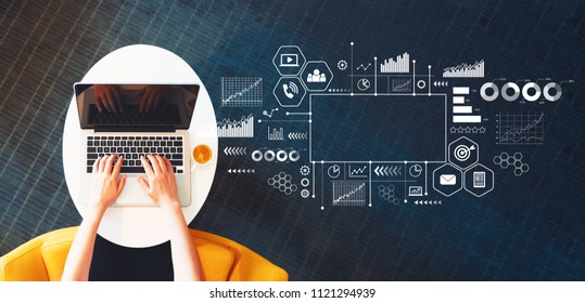 Marketing concept with person using a laptop on a white table