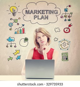Marketing Plan concept with young woman working on a laptop