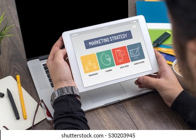 MARKETING STRATEGY CONCEPT ON TABLET SCREEN