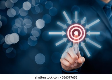 Marketing targeting, goal and trigger concepts. Businessman click on virtual target, bokeh in background.