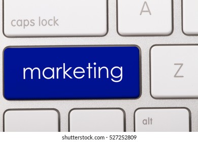Marketing word written on computer keyboard.