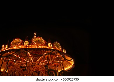 Marketplace carousels, fun for childrens and parents,  fair attraction, Winter Christmas market, Germany.