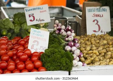 Marketplace with garden truck, vegetables, fruits, berries etc. in Helsinki, Finland