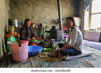 Markha, India - September 12, 2019: Women cooking in a tourist homestay in Hankar village along the Markha Valley trek, Ladakh region, northern India