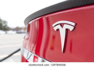 MARKHAM, CANADA - April 24, 2019: Red Tesla Model S rear badge as vehicle is supercharged at Tesla CF Markham Supercharger.