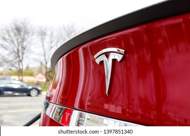 MARKHAM, CANADA - April 24, 2019: Red Tesla Model S rear badge as vehicle is supercharged at Tesla SmartCentres Markham Woodside Supercharger.