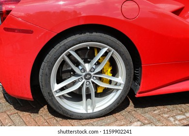 MARKHAM CANADA - JULY 29 2018: A red Ferrari car wheel and rim at Unionville Exotic Car Show featuring luxury cars, exotic, expensive cars on Main Street, Markham