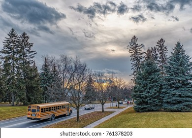 MARKHAM, CANADA - NOVEMBER, 21, 2017: Autumn landscape with a classic  yellow school bus in Canadian suburbs at sunset
