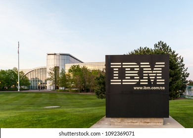 Markham, Ontario, Canada - May 16th, 2018: Sign of IBM with Canada Head Office Building in background in Markham, Ontario, Canada. IBM is an American multinational technology company.