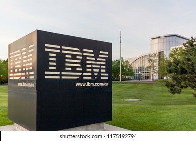 Markham, Ontario, Canada- May 16th, 2018: IBM Sign with IBM Canada Head Office Building in background in Markham, Ontario. IBM is an American multinational technology company.