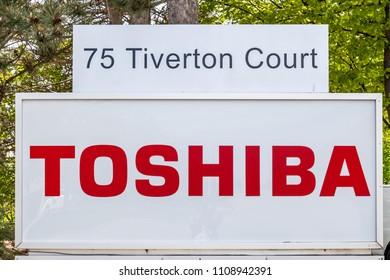 Markham, Ontario, Canada - May 21, 2018: Sign of Toshiba Canada at head office near Toronto in Markham. Toshiba Corporation is a Japanese multinational conglomerate.