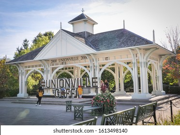 Markham, Ontario, Canada - October 6, 2019: Tourists visiting Millenium Bandstand in the Village of Unionville.