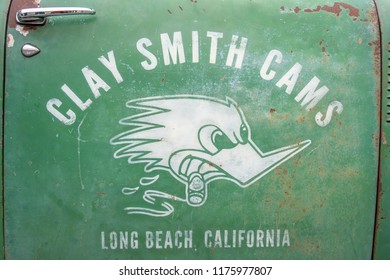Markham, Ontario / Canada – September 9, 2018: The weathered and worn front passenger door of a vintage and classic green and black 1951 GMC pickup truck, with a cigar smoking woodpecker as a logo.