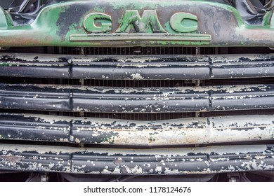 Markham, Ontario / Canada – September 9, 2018: The weathered and worn front grill of a vintage and classic green and black 1951 GMC pickup truck.