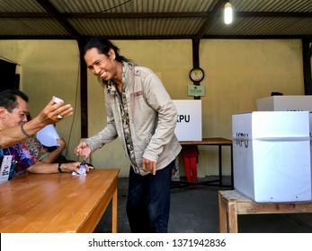 Marking hand with ink to the KPPS officer. Atmosphere of Indonesian General Election 2019 TPS 99 Pringgolayan Banguntapan Bantul DI. Yogykarta Aprill 17 2019.