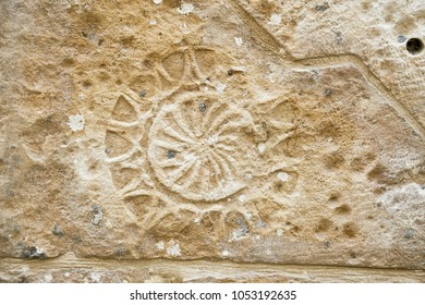 Marks engraved in the stone of historic buildings in the old city of Nablus. Possibly Roman or inspired by Roman art.