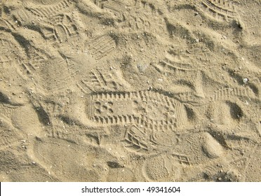 marks from shoes on the sand