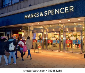 Marks & Spencer store illuminated at night with Christmas shoppers. Princes street Edinburgh, Scotland UK. DECEMBER 2017