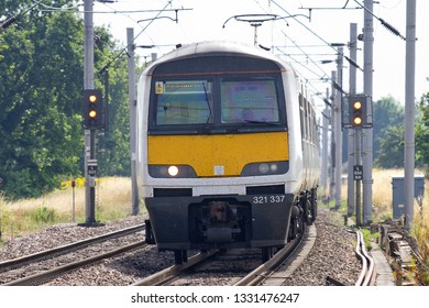 MARKS TEY, ESSEX, UK - JULY 27, 2013: Greater Anglia Class 321 No. 321337 leads a passenger service through Marks Tey.