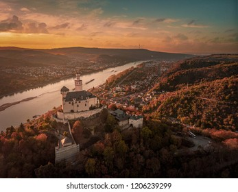 Marksburg castle during autumn fall season, romantic white castle in the mountain during sunset Braubach Germany middle Rhine Valley
