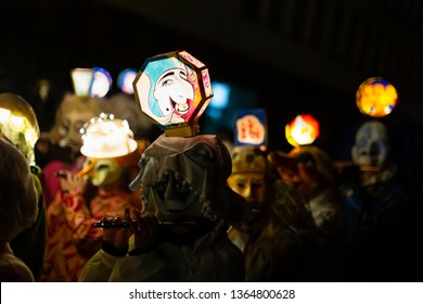 Marktgasse, Basel, Switzerland - March 11th, 2019. Close-up of piccolo players in their individual carnival costumes with illuminated head lanterns.