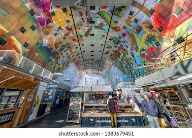 MARKTHAL, 13 April 2019 - Inner view of the Rotterdam market hall with its huge wall drawing, painting where several type of food are served with delicate settings